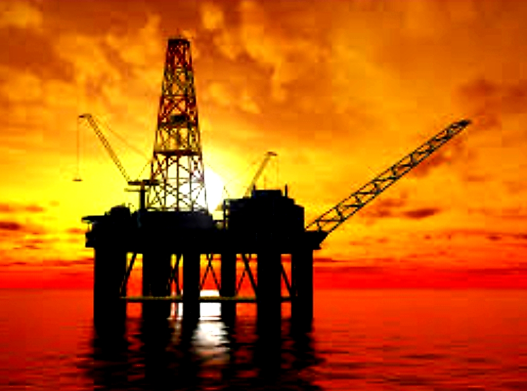 Offshore Drilling Rig With The Sun Rising In The Background
