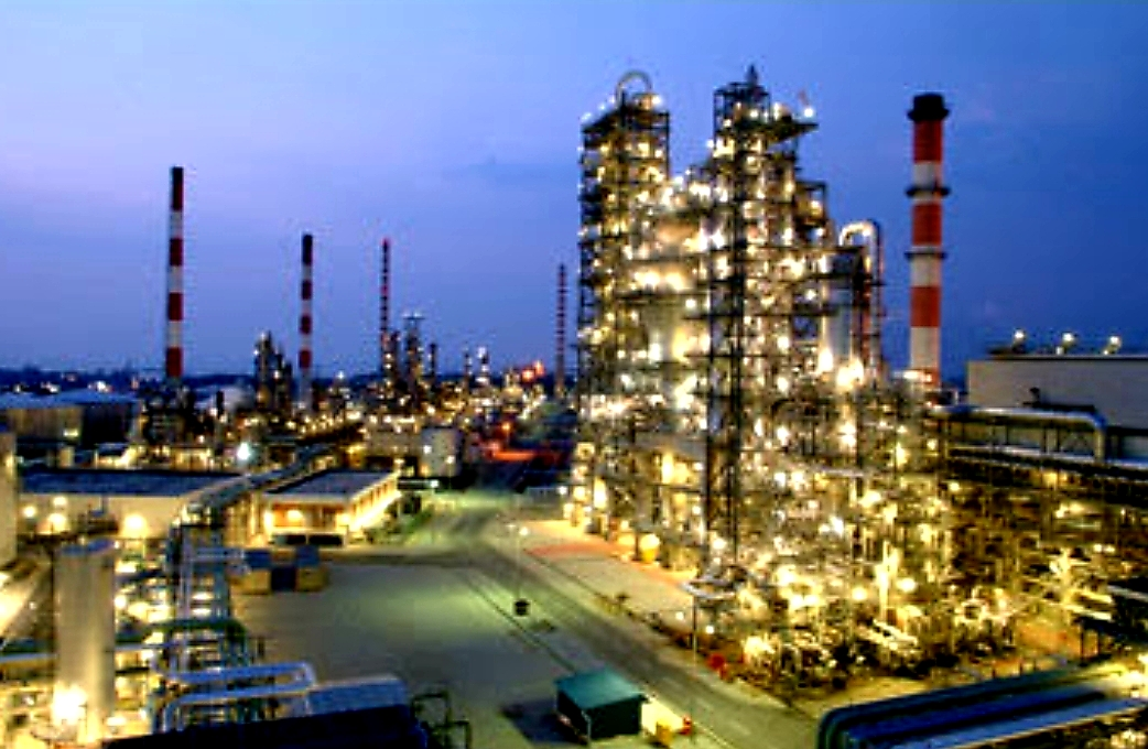 Oil Refinery Lit Up At Night Photo